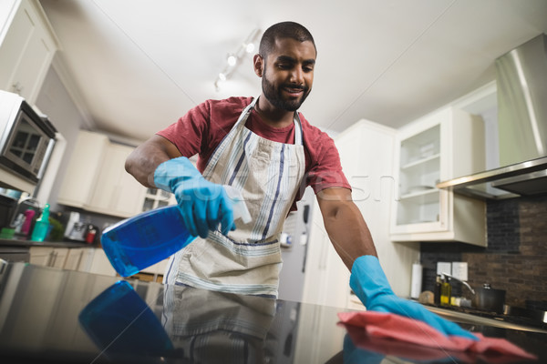 Low angle view of man cleaning marble counter in kitchen Stock photo © wavebreak_media