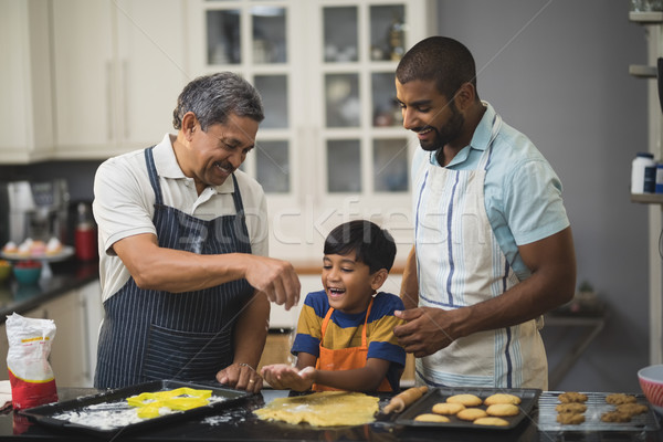 Multi-generation family preparing food in kitchen Stock photo © wavebreak_media