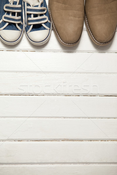 Pairs of new shoes on wooden plank Stock photo © wavebreak_media