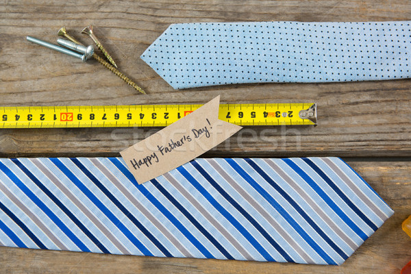 Overhead view of text with neckties and work tools on table Stock photo © wavebreak_media