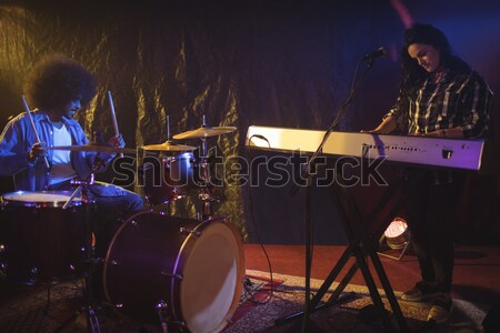 Male drummer performing in illuminated nightclub Stock photo © wavebreak_media
