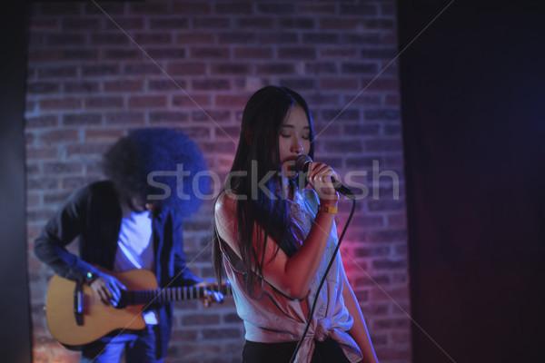 Female singer with male guitarist performing at music concert Stock photo © wavebreak_media
