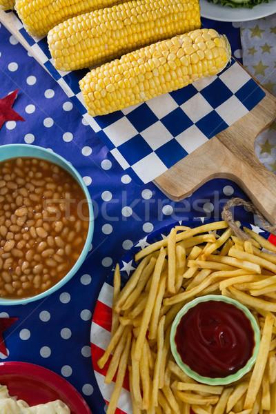 картофель фри кукурузы деревянный стол продовольствие Сток-фото © wavebreak_media