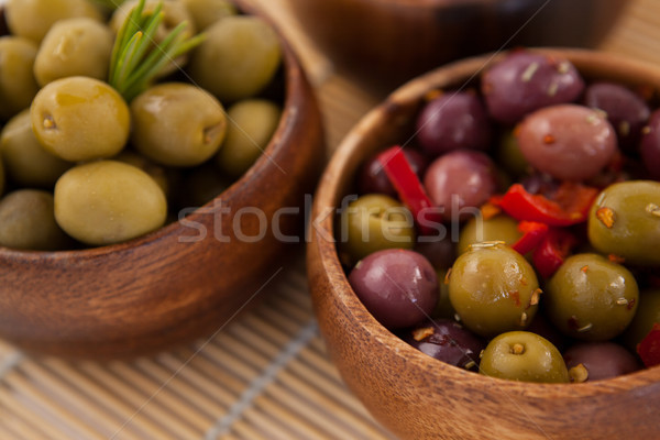 Close up of olives in wooden container Stock photo © wavebreak_media