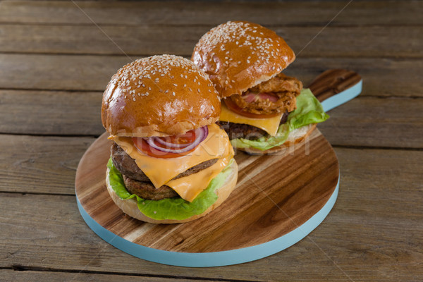 Hamburgers on chopping board Stock photo © wavebreak_media