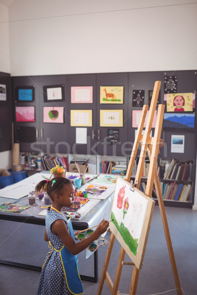 High angle side view of girl painting on canvas Stock photo © wavebreak_media