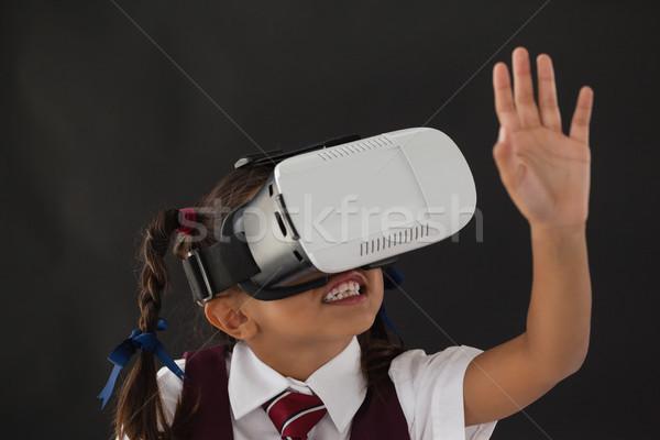 Aluna virtual realidade fone lousa sala de aula Foto stock © wavebreak_media