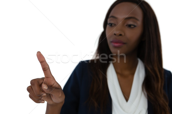 Jonge zakenvrouw aanraken denkbeeldig scherm Stockfoto © wavebreak_media