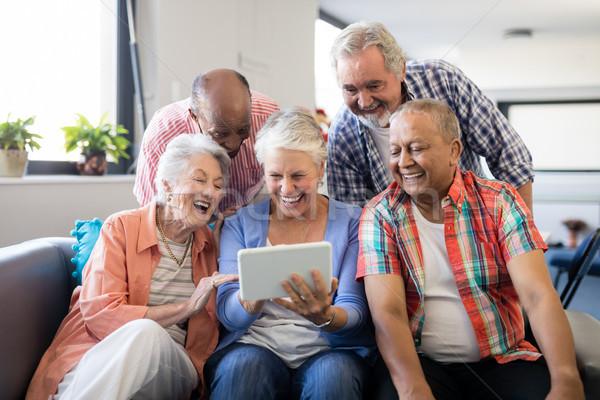 Derűs idős barátok néz digitális tabletta Stock fotó © wavebreak_media