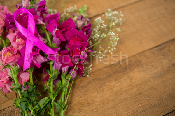 High angle view of pink Breast Cancer Awareness ribbon on flowers Stock photo © wavebreak_media