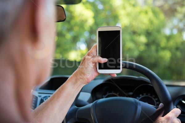 Kıdemli kadın cep telefonu sürücü araba aktif Stok fotoğraf © wavebreak_media