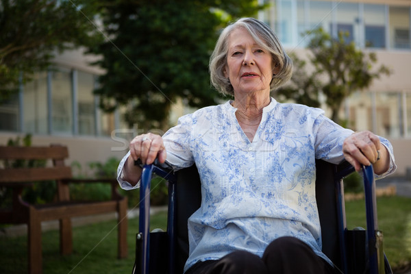 Portret starszy kobieta posiedzenia wózek parku Zdjęcia stock © wavebreak_media