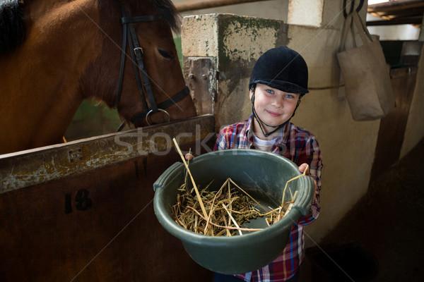 Menina cavalo estável adorável grama Foto stock © wavebreak_media