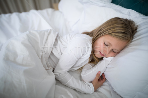 Girl sleeping on bed in bedroom Stock photo © wavebreak_media