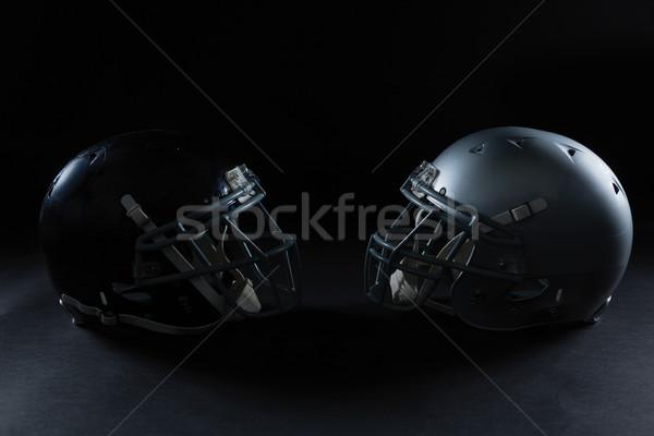 American football head gear facing each other Stock photo © wavebreak_media