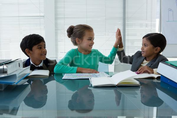 Happy business people working in boardroom Stock photo © wavebreak_media