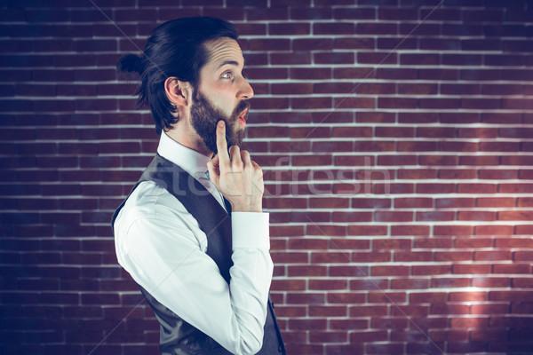 Zamyślony przystojny mężczyzna strony podbródek murem człowiek Zdjęcia stock © wavebreak_media