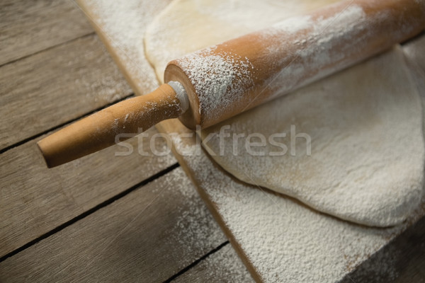 High angle view of rolling pin on rolled dough over cutting board Stock photo © wavebreak_media