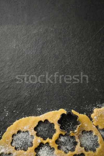 Directly above shot of flower shape mould on dough Stock photo © wavebreak_media