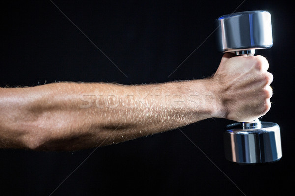 Cropped image of man working out with dumbbell Stock photo © wavebreak_media