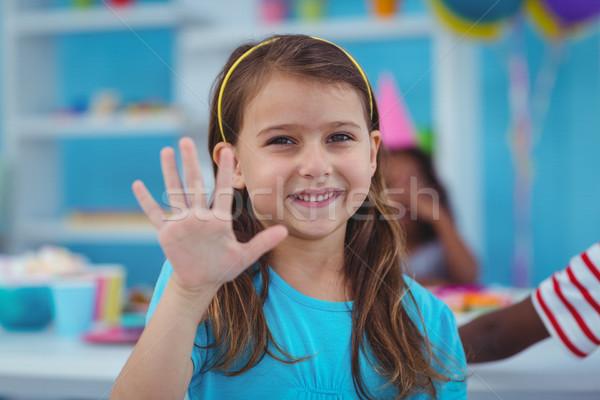 Feliz criança festa de aniversário mão menina Foto stock © wavebreak_media
