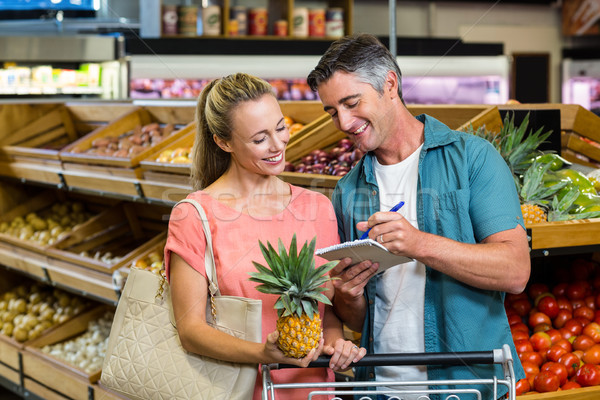 笑みを浮かべて カップル 見える 食料品 リスト スーパーマーケット ストックフォト © wavebreak_media