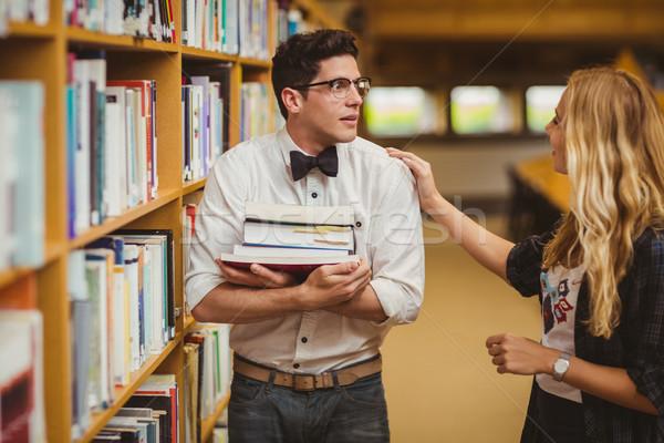Avergonzado nerd reunión hasta nina biblioteca Foto stock © wavebreak_media