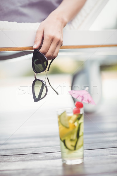 Close-up of womans hand holding sunglasses Stock photo © wavebreak_media