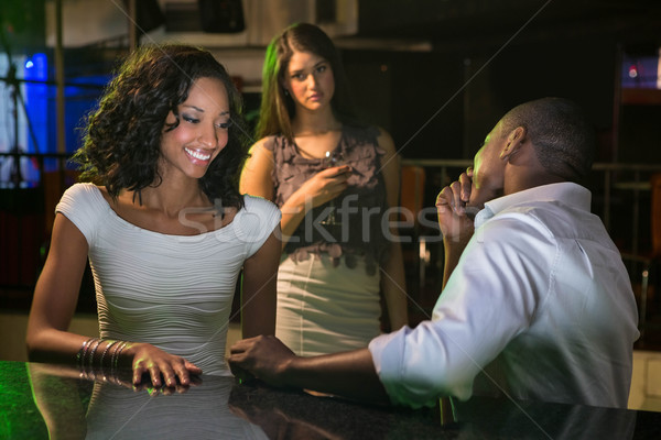 Unhappy woman looking at a couple flirting near bar counter Stock photo © wavebreak_media