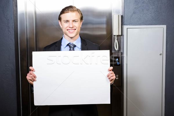 Businessman holding a signboard Stock photo © wavebreak_media