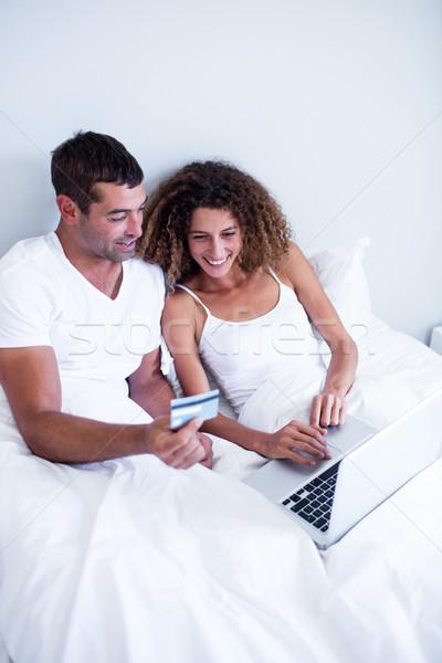 Couple shopping online  Stock photo © wavebreak_media