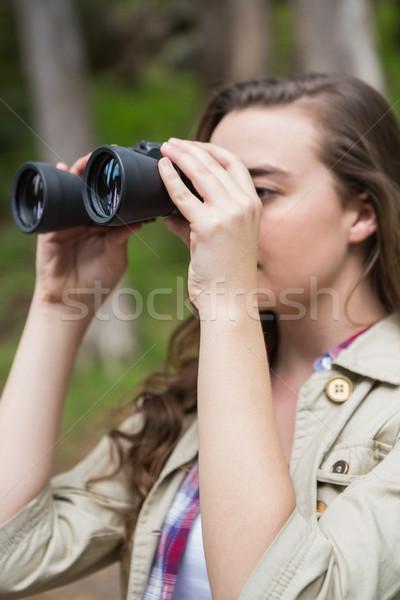 Stock photo: Woman using binoculars