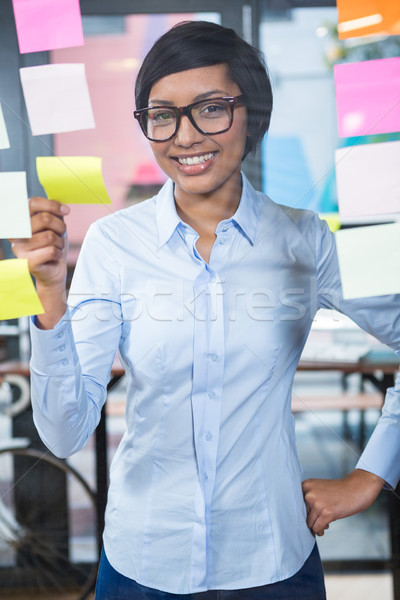 Portrait of businesswoman with sticky note  Stock photo © wavebreak_media