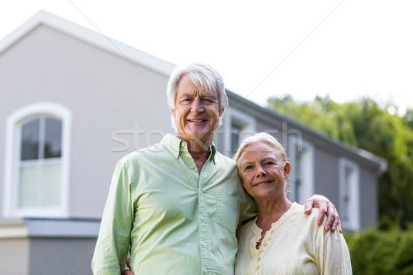 Senior couple standing in yard against house Stock photo © wavebreak_media