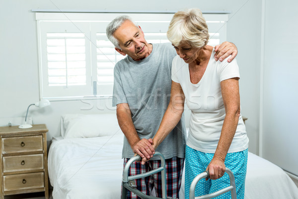 Senior woman with walker by man in bedroom Stock photo © wavebreak_media