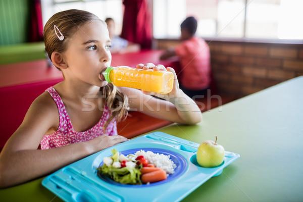Gyermek iszik étkezde iskola lány alma Stock fotó © wavebreak_media