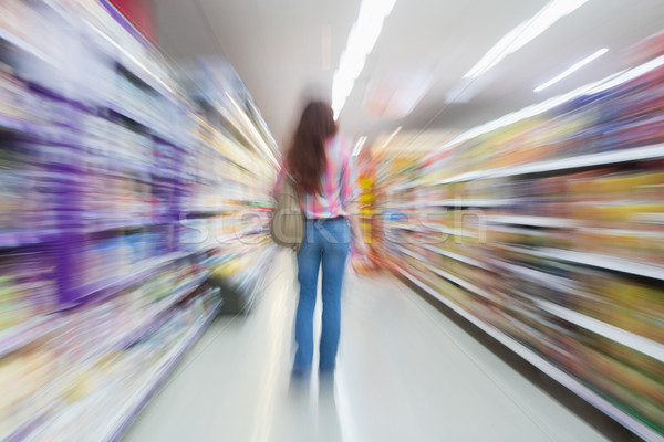 Rear view of woman standing in aisle with blurred effects Stock photo © wavebreak_media