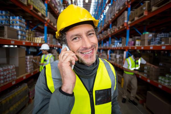 Munkás mobiltelefon raktár üzlet férfi technológia Stock fotó © wavebreak_media