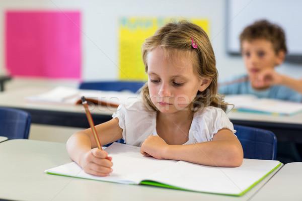 Grave ragazza iscritto libro classe bambino Foto d'archivio © wavebreak_media