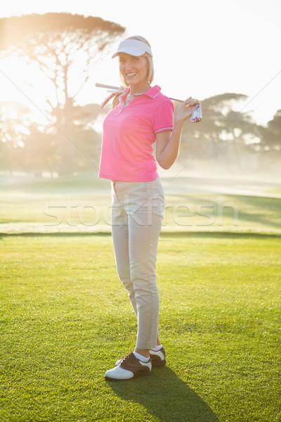 женщину гольфист позируют гольф клуба области Сток-фото © wavebreak_media