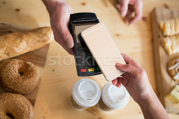 Woman making payment through NFC Stock photo © wavebreak_media