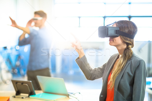 Female graphic designer using the virtual reality headset Stock photo © wavebreak_media