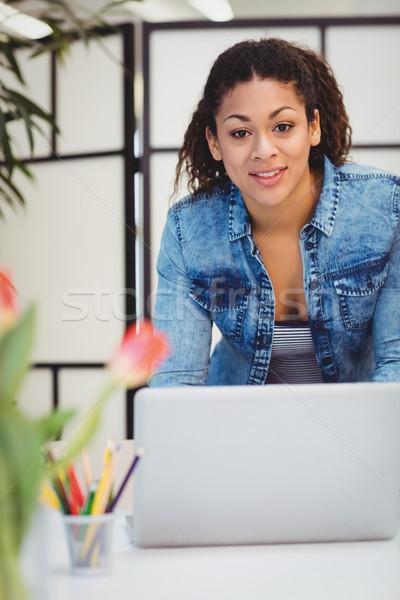 Portrait of businesswoman using laptop  Stock photo © wavebreak_media