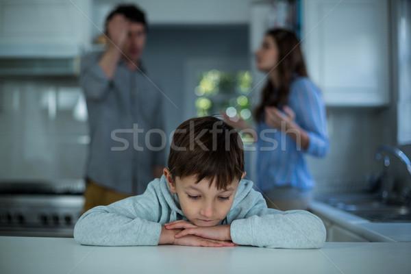 Sconvolto ragazzo seduta Coppia argomento cucina Foto d'archivio © wavebreak_media