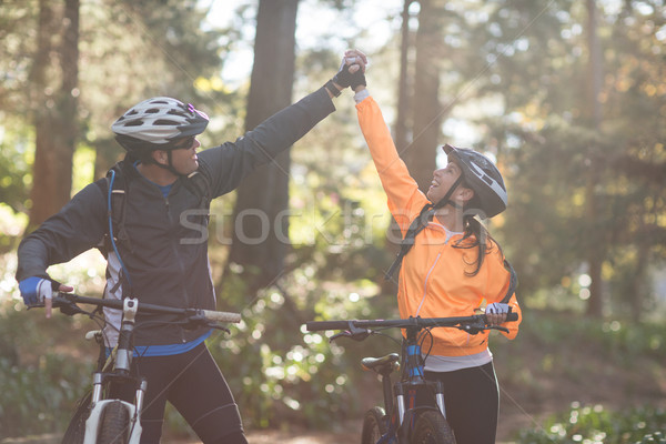 Biker couple holding each others hands Stock photo © wavebreak_media