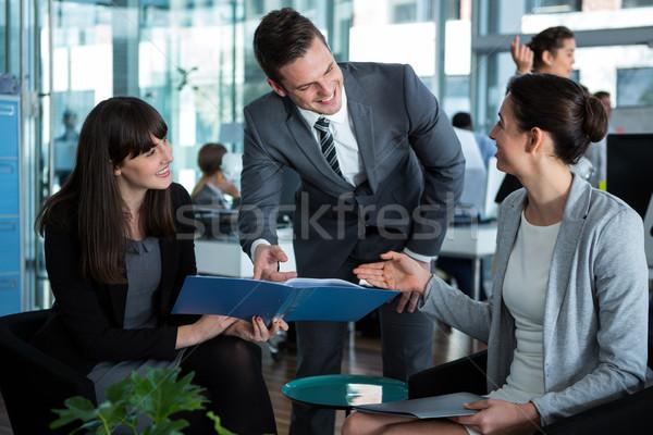 Businesspeople discussing over document Stock photo © wavebreak_media