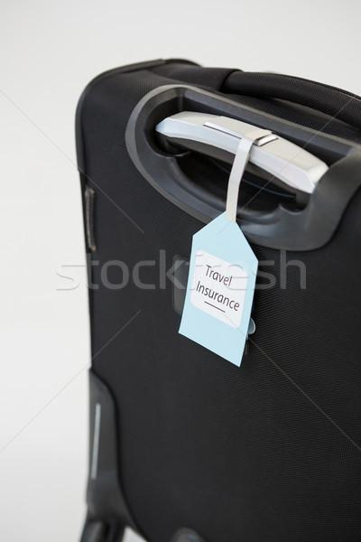 Seyahat sigorta etiket bavul iş Stok fotoğraf © wavebreak_media