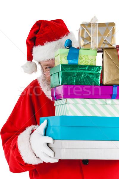 Santa claus hiding behind the gifts Stock photo © wavebreak_media