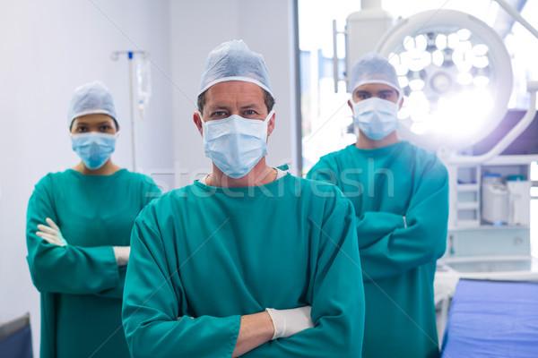Takım cerrahlar cerrahi maske operasyon tiyatro Stok fotoğraf © wavebreak_media