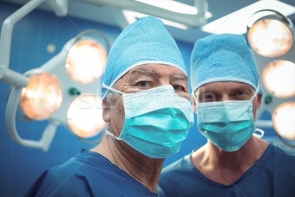Retrato masculino cirurgiões máscara cirúrgica operação Foto stock © wavebreak_media